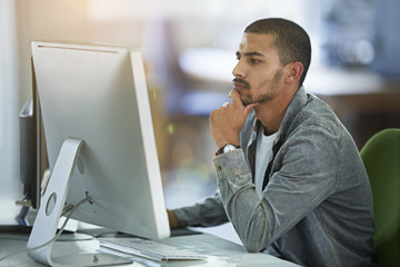 Online distance education student looking at large computer screen.