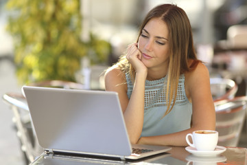University student studying online at her own leisurely pace.