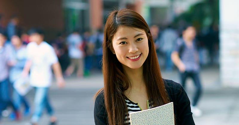 Smiling MBA graduate